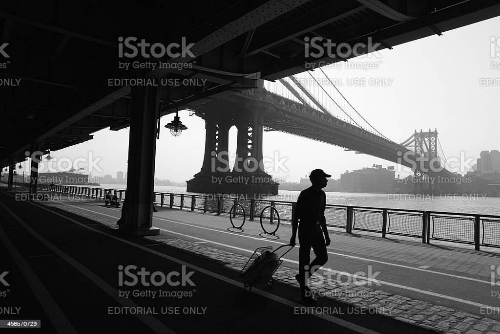 New York Lower East Side walker and Manhattan Bridge stock photo
