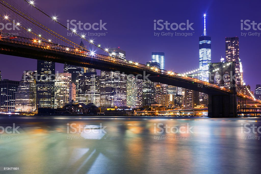 New York, Manhattan Skyline with Brooklyn Bridge at Night stock photo