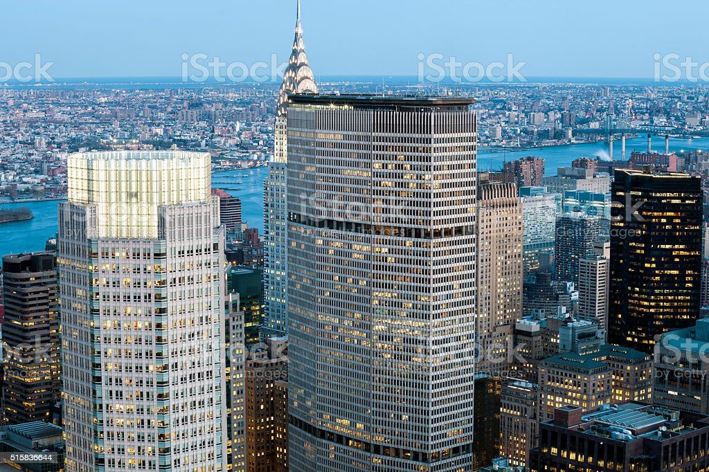 New York, Midtown Manhattan Skyscrapers Illuminated at Dusk stock photo