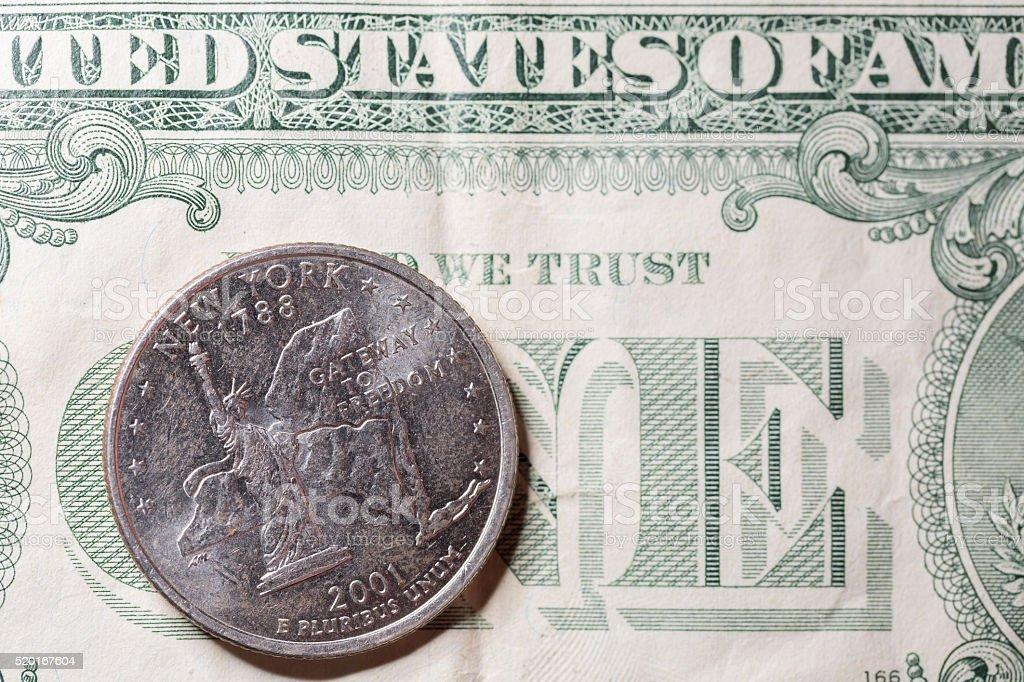 US New York Quarter on One Dollar Bill stock photo