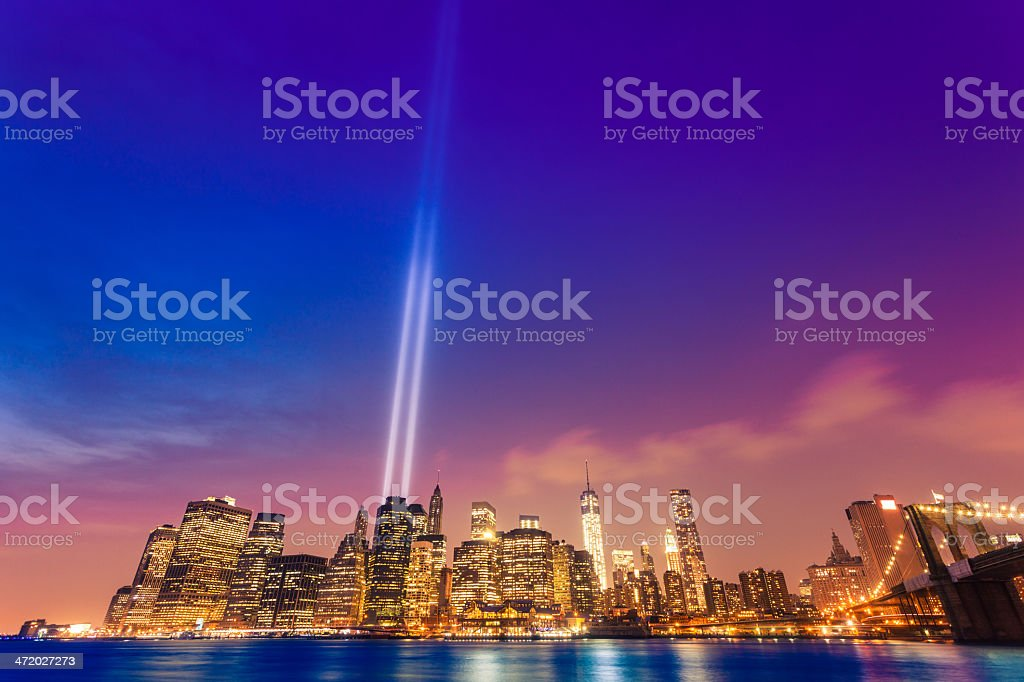 New York Skyline and Brooklyn Bridge with 11 September Lights stock photo