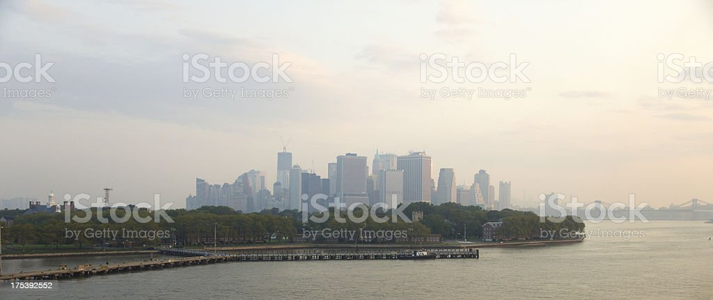 New York Skyline at Dawn with Governors Island in Foreground stock photo