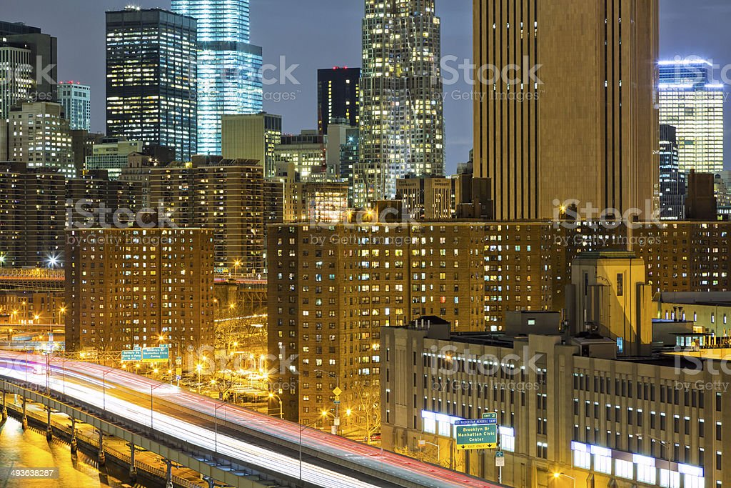New York Skyline At Night With Car Light Trails stock photo