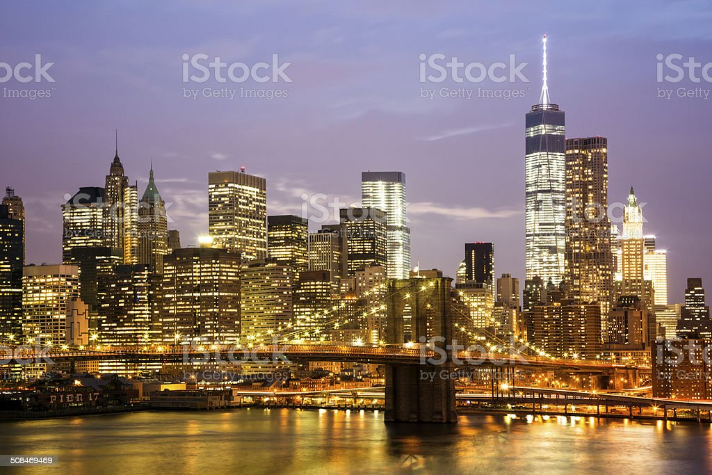 New York Skyline With Brooklyn Bridge at Dusk royalty-free stock photo