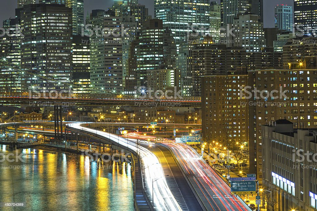 New York Skyline With Traffic On FDR Drive at Night stock photo