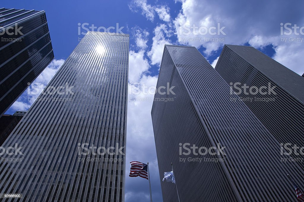 New York Skyscrapers and US Flag Reaching for the Sky royalty-free stock photo
