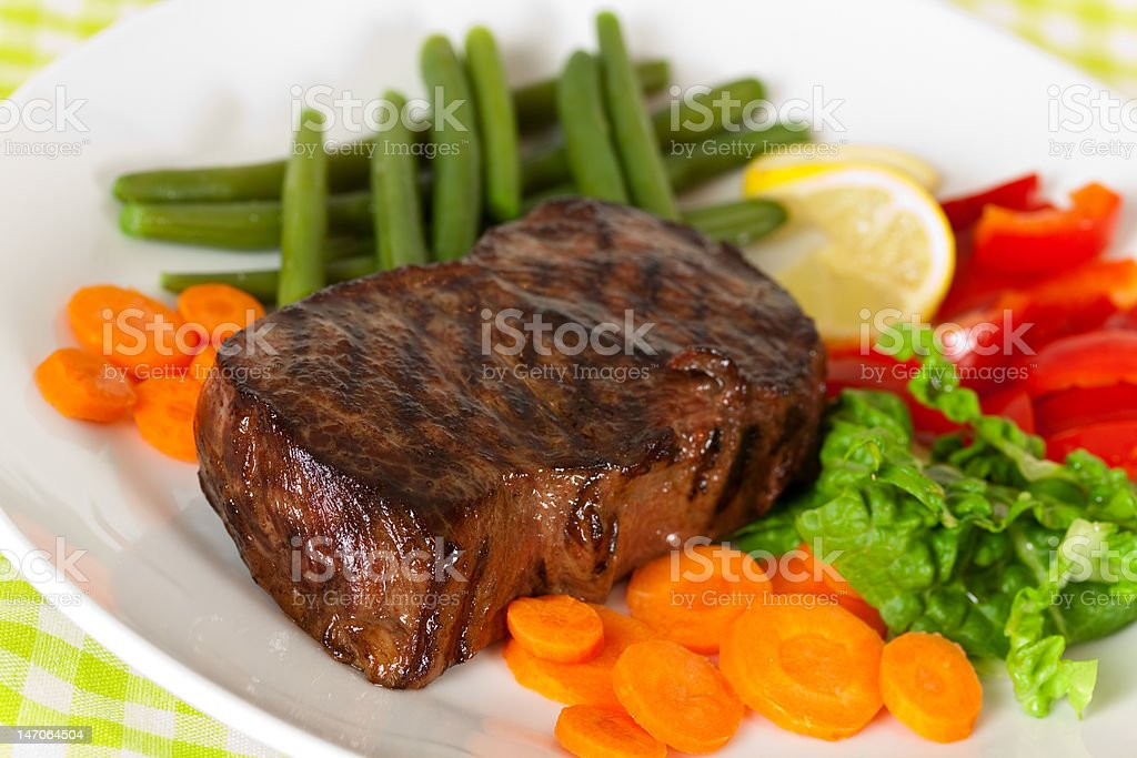 New York Steak- Carrot,Pepper and green salad over plate royalty-free stock photo