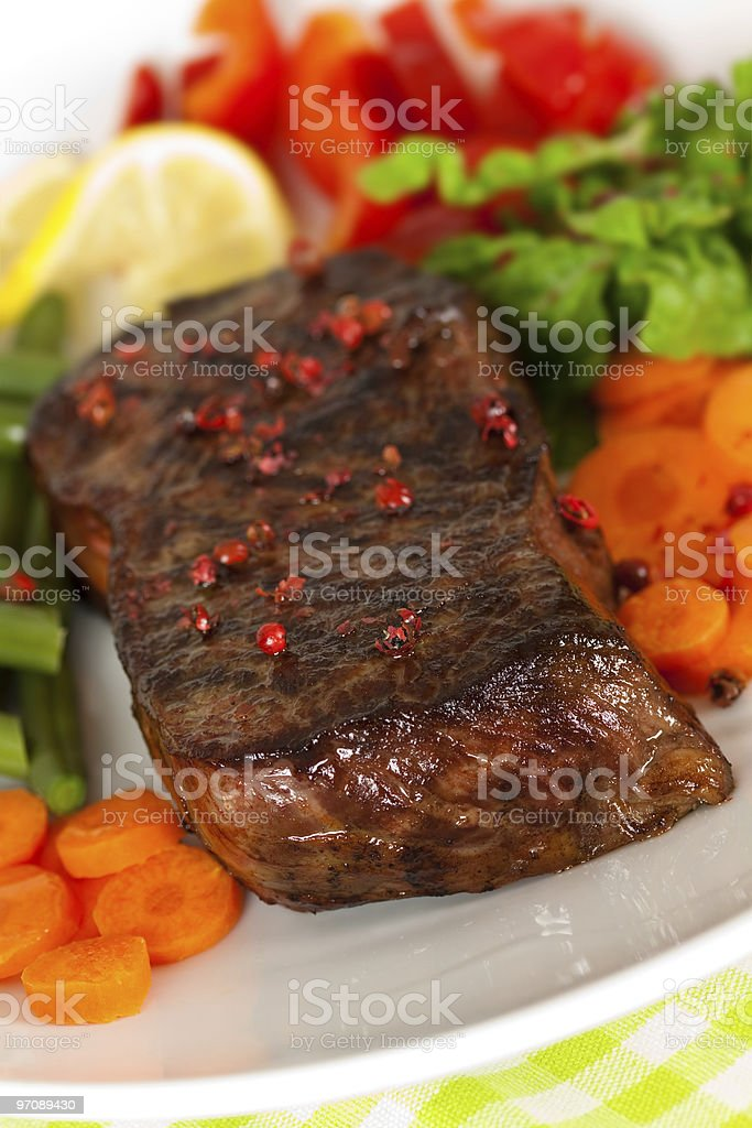 New York Steak- Green Beans,Carrot,Pepper,salad over plate royalty-free stock photo