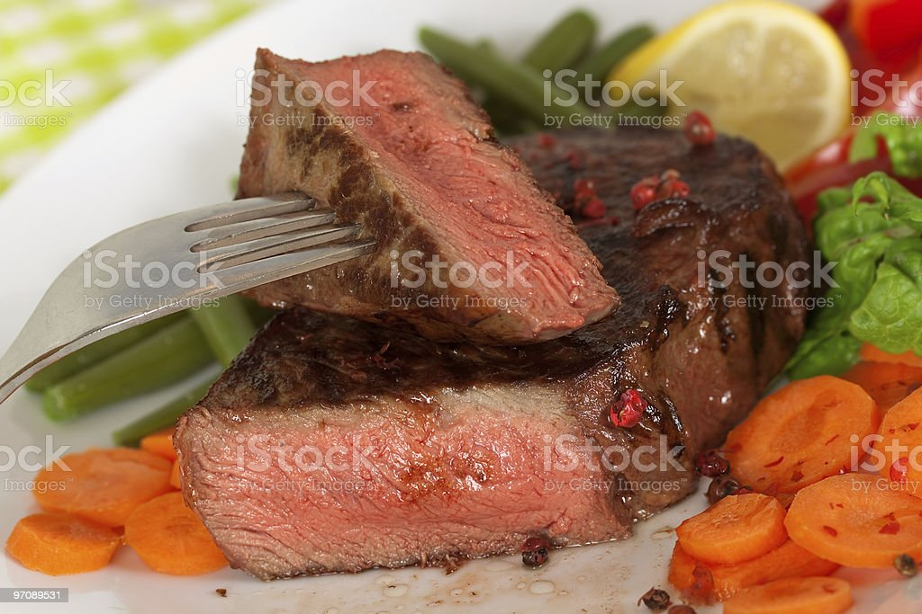 New York Steak- Green Beans,Carrot,Pepper,salad over plate royalty-free stock photo