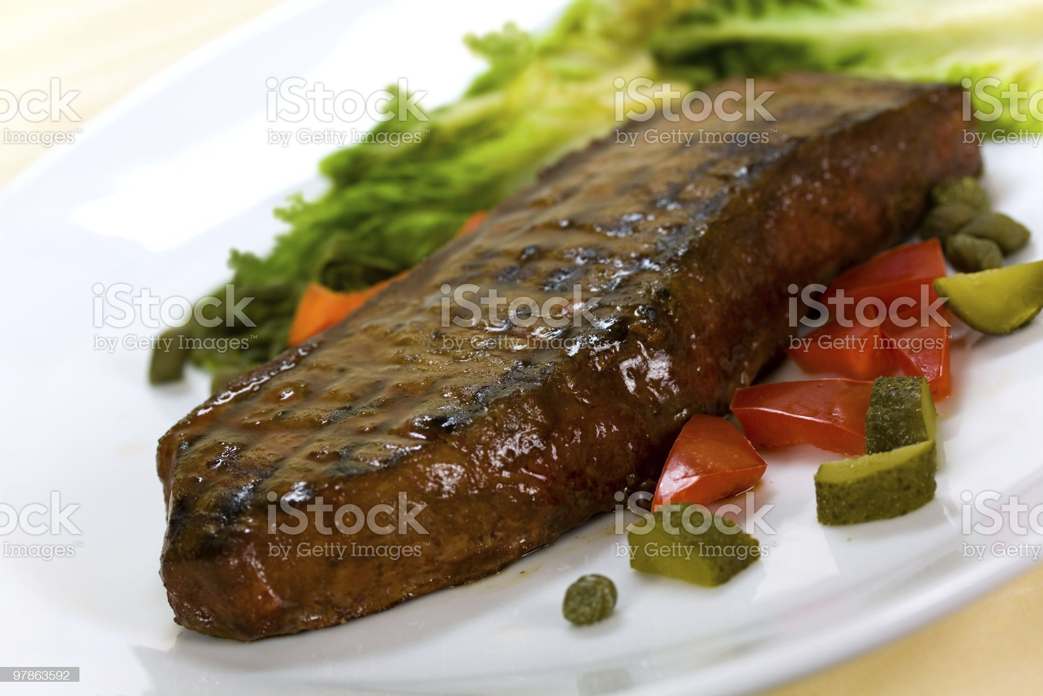 New York Steak- over plate,with Peppers royalty-free stock photo