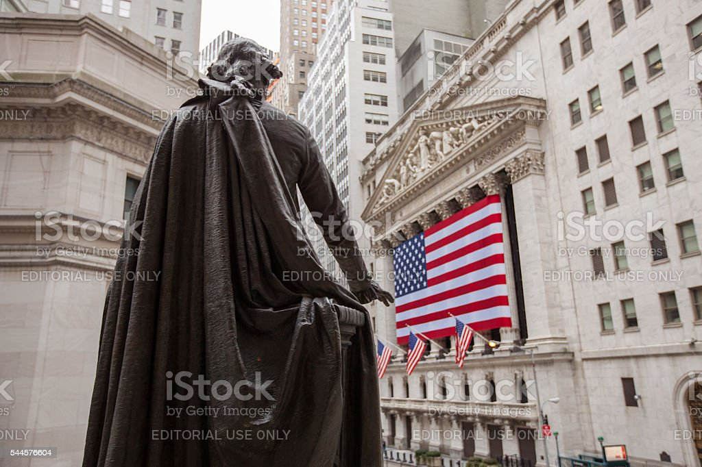 New York Stock Exchange building sign and George Washington statue stock photo