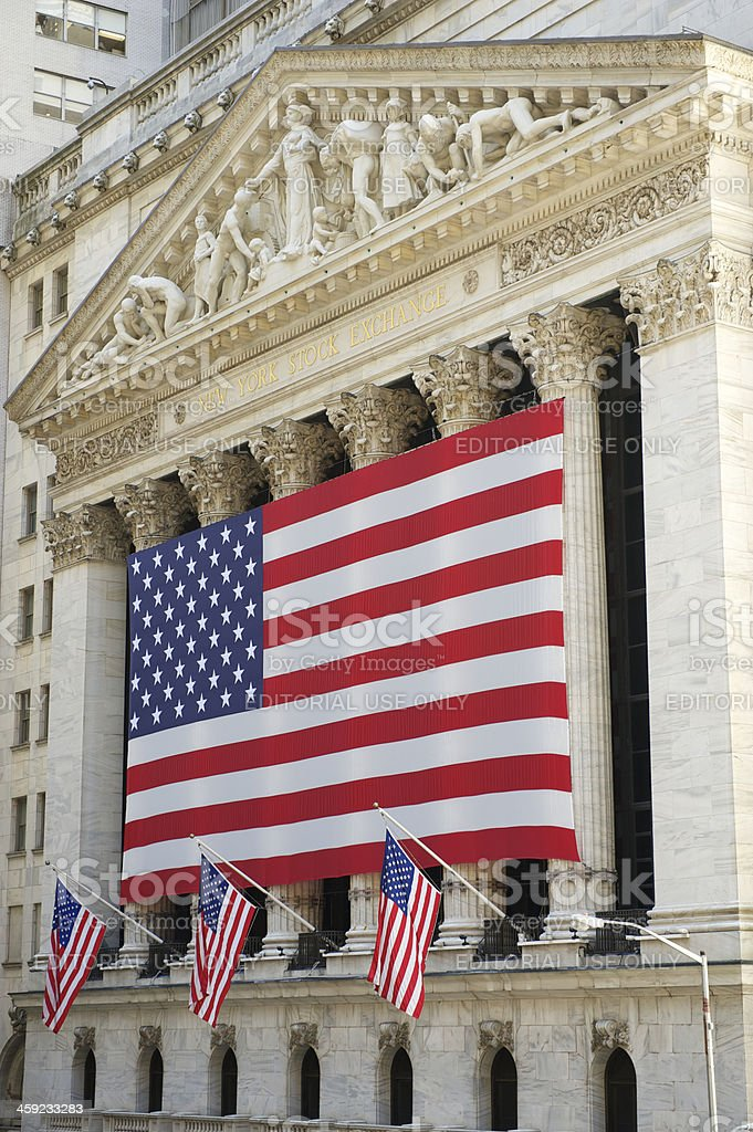 New York Stock Exchange Vertical with American Flags royalty-free stock photo