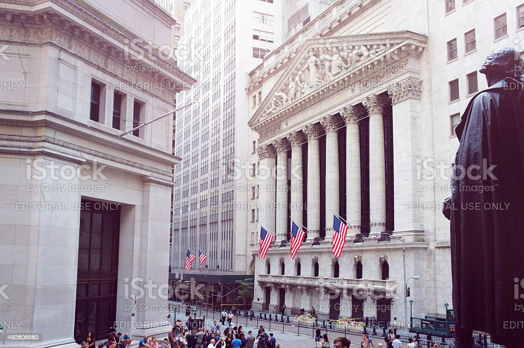 New York Stock Exchange, Wall street on summer morning. stock photo
