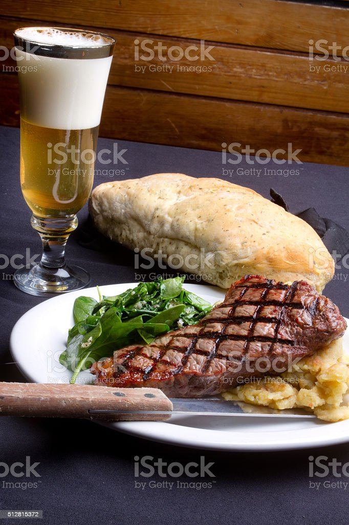 New York Strip Beef Steak Dinner and Beer stock photo