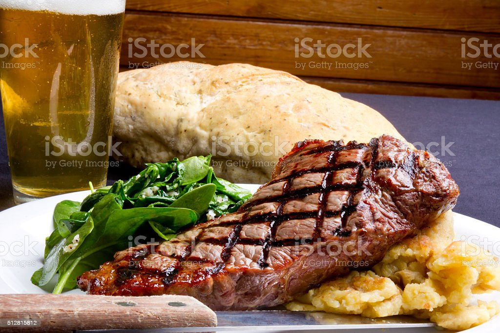 New York Strip Beef Steak Dinner and Beer stock photo