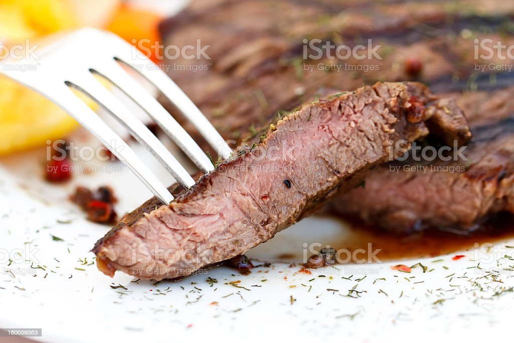New York Strip Steak,grilled,with baked potato royalty-free stock photo