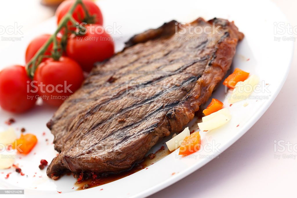 New York Strip Steak,grilled,with  cherry tomato royalty-free stock photo