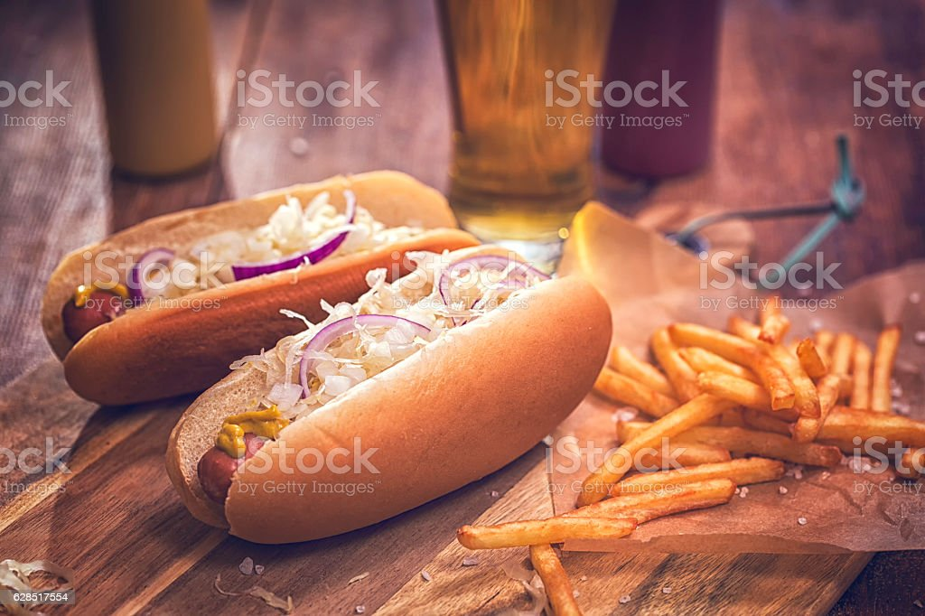 New York Style Hot Dog with Sauerkraut, Onions and Mustard stock photo