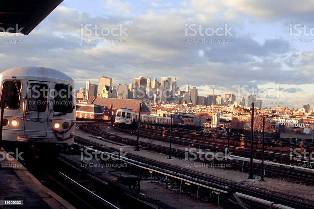 New York Subway Station With Trains - Manhattan Skyline royalty-free stock photo