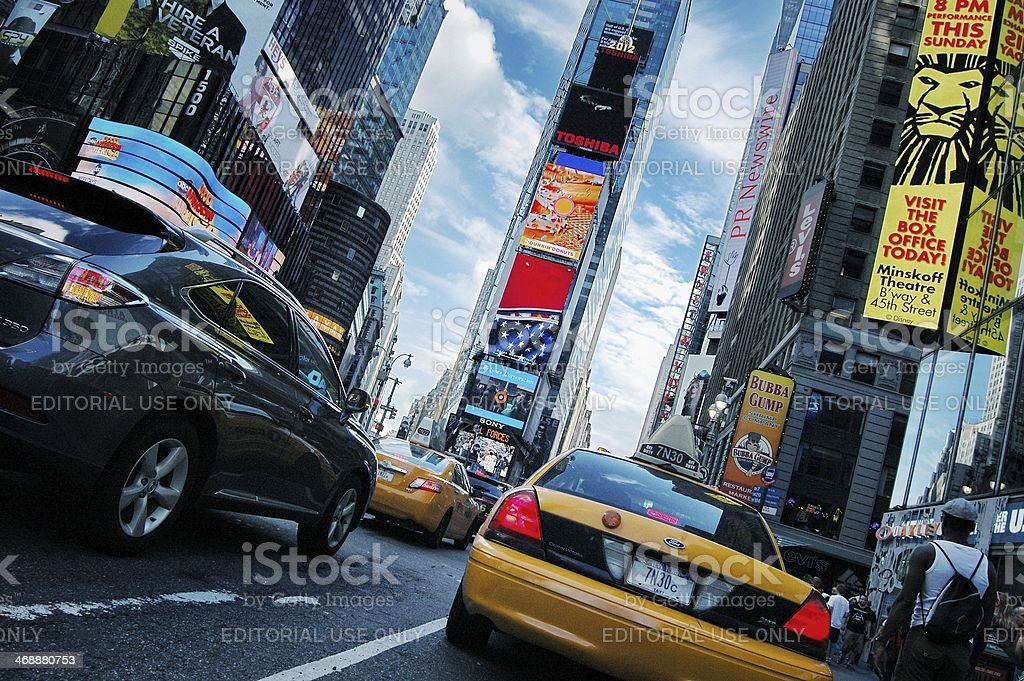 New York, Times Square low angle view, taxi and skyscrapers. royalty-free stock photo