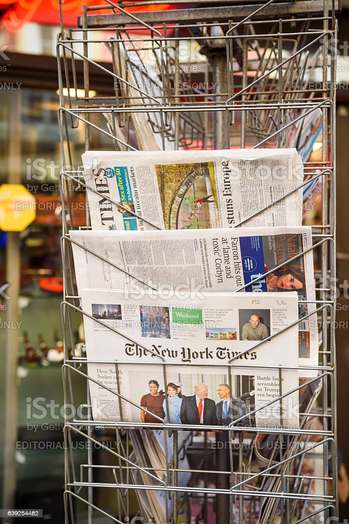 New York Times, The Guardian newspaper from a newsstand stock photo
