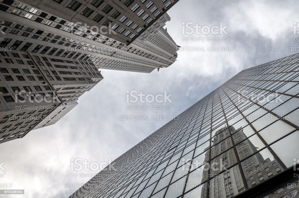 New York, USA. October 2012. New York city skyscraper reflects on glass building. stock photo