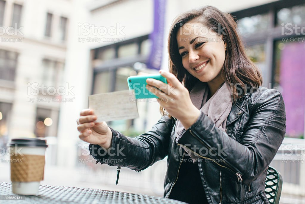 New York Woman Depositing Check Remotely royalty-free stock photo