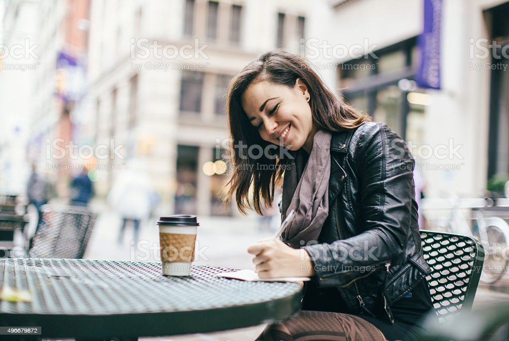 New York Woman Journaling in Park stock photo