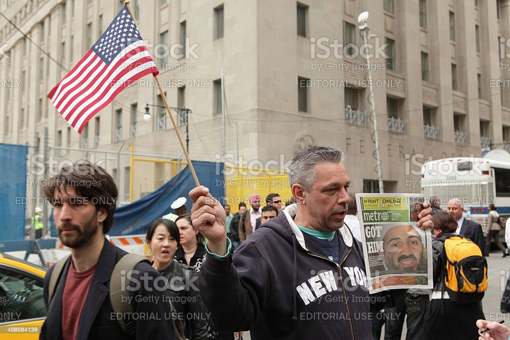 New Yorker waves flag Bin Laden death May 2 2011 stock photo