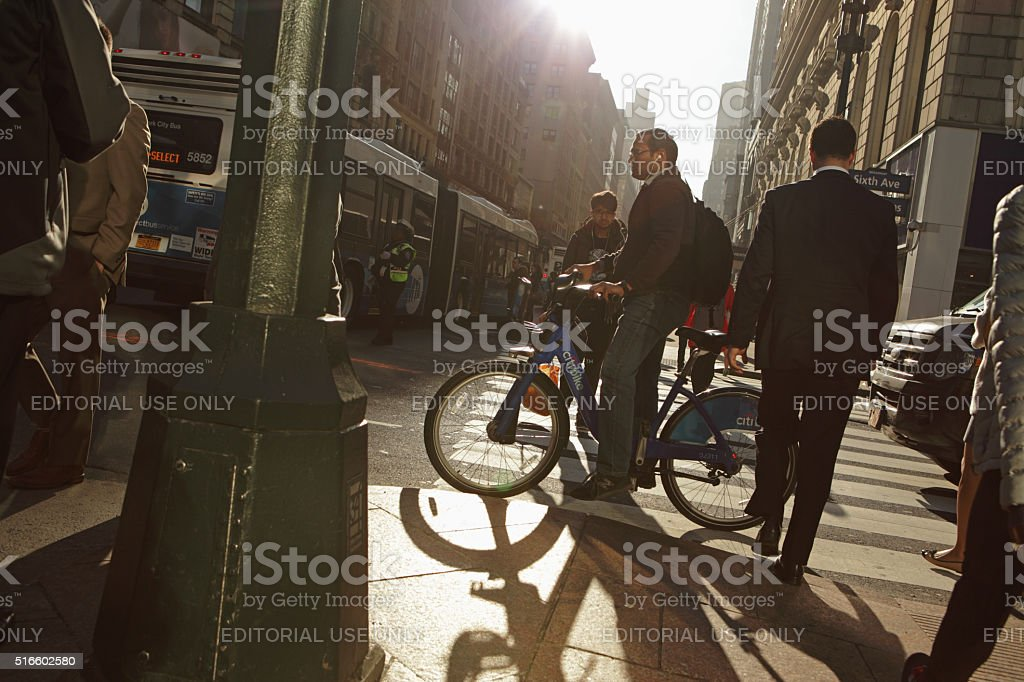 New Yorkers crossing 6th Avenue in Manhattan at rush hour stock photo
