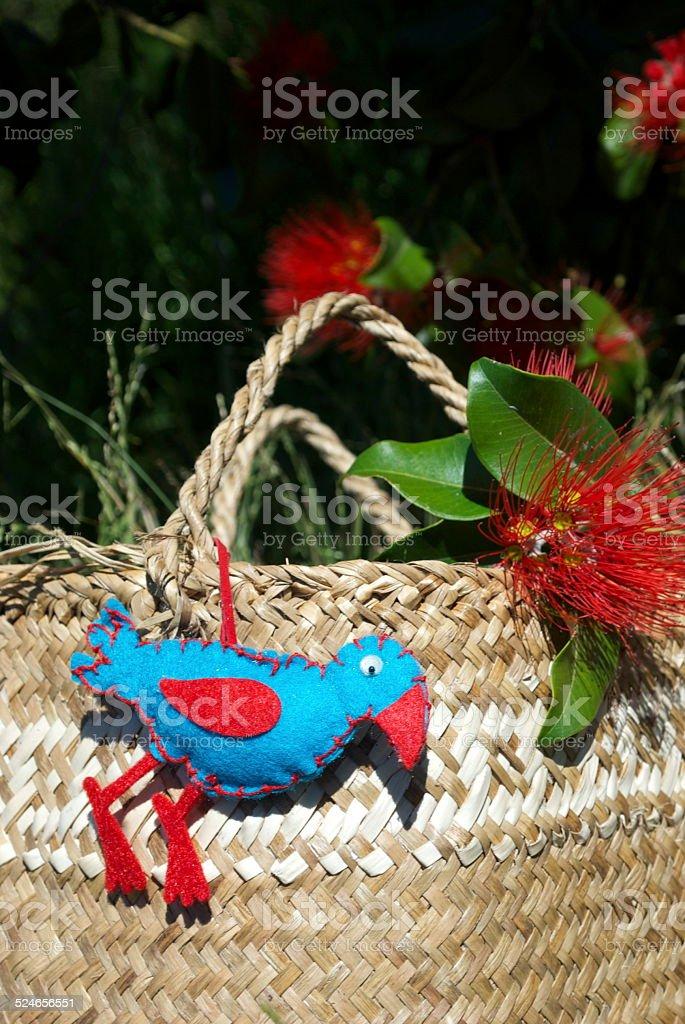 New Zealand Christmas, a Kete with Decorations & a Pohutakawa Tree stock photo