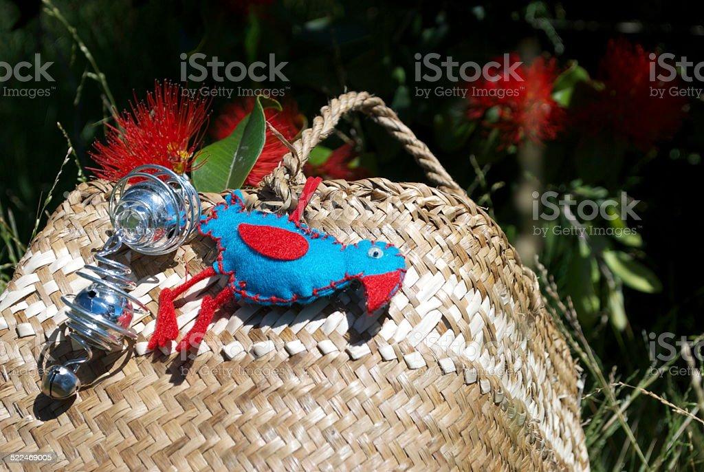 New Zealand Christmas, a Kete with Decorations and a Pohutakawa Tree stock photo
