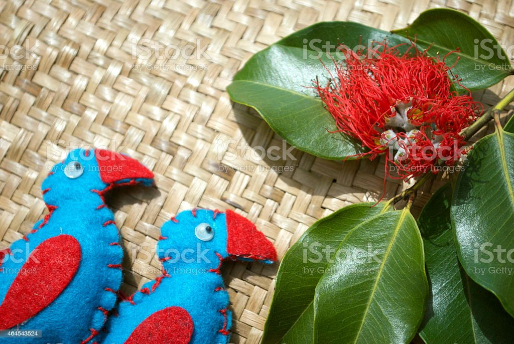 New Zealand Christmas; Pukekos, Kete and Pohutakawa Flower stock photo