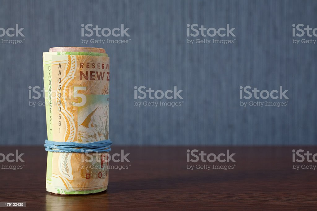 New Zealand Currency Money Roll stock photo