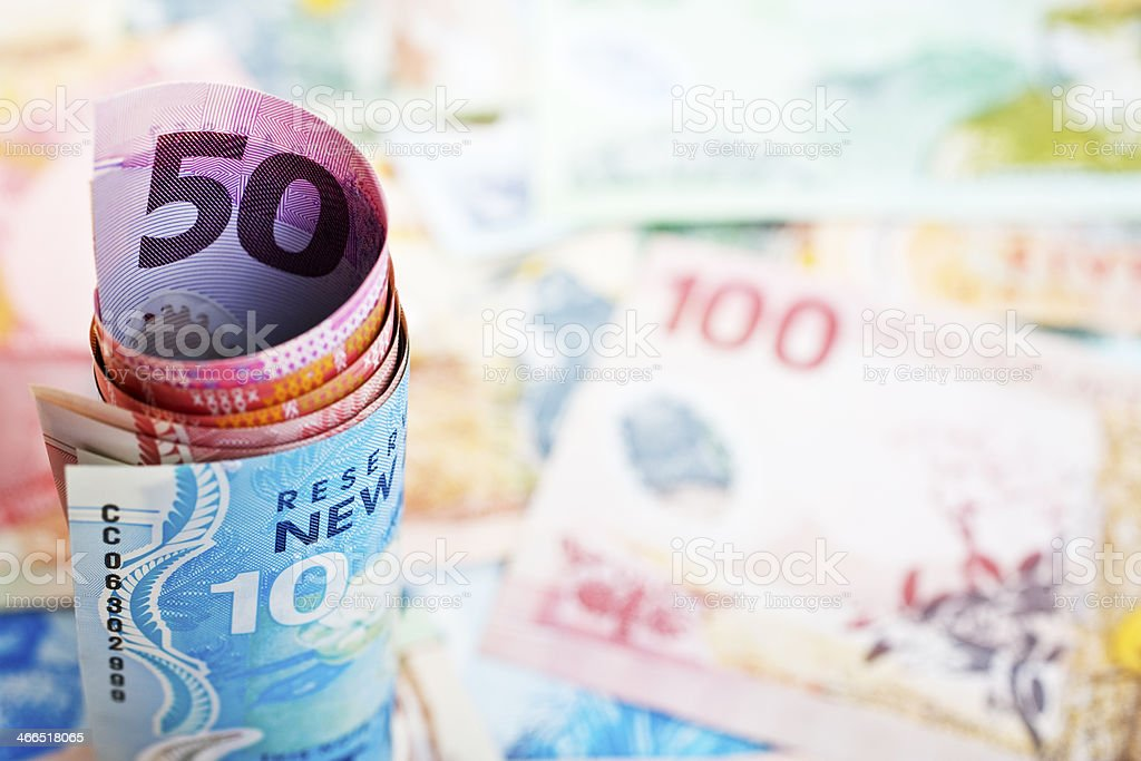 New Zealand Currency Roll and Background stock photo