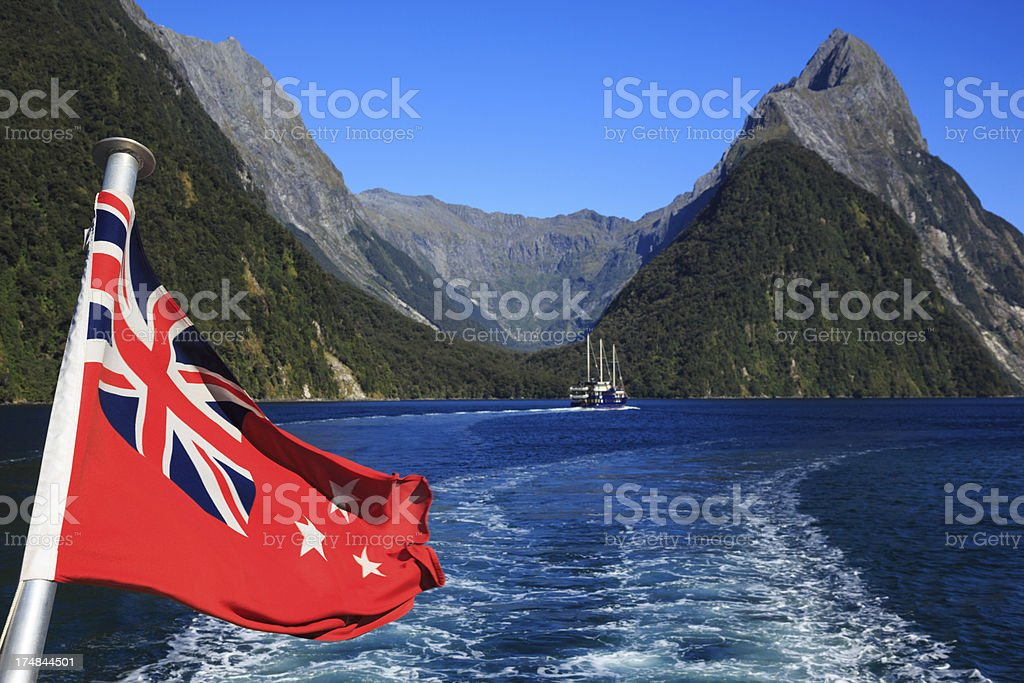 New Zealand Flag in Milford Sound stock photo
