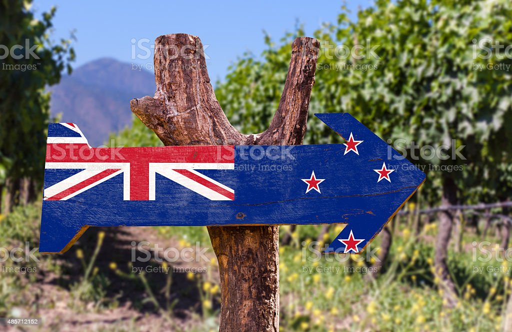 New Zealand Flag wooden sign with winery background stock photo