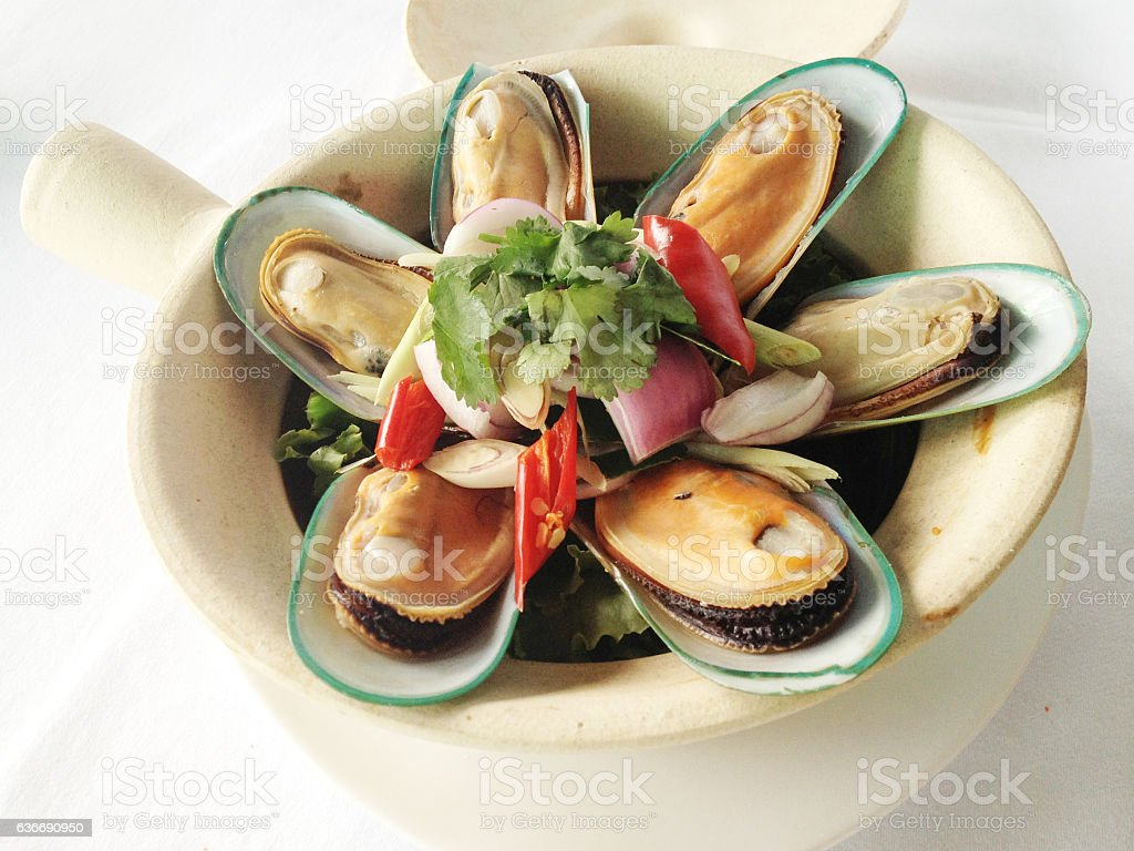 new zealand mussel and thai herbs baked in clay pot stock photo