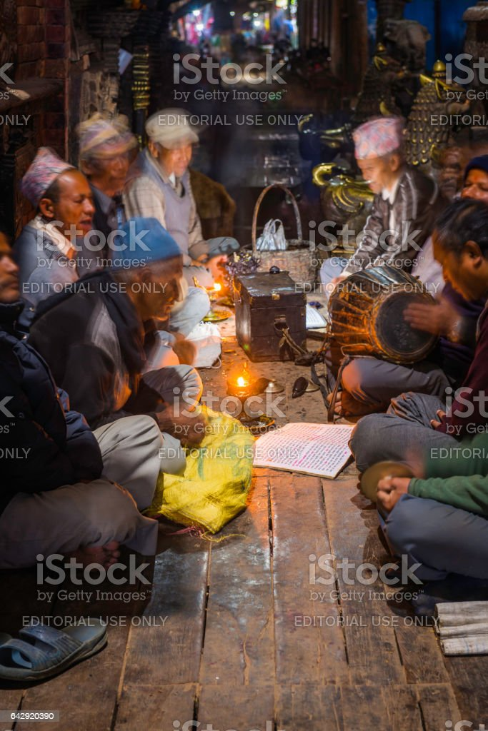 Newar men singing devotional songs at night Bhaktapur Kathmandu Nepal stock photo