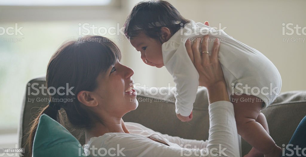 Newborn Baby and Her Mother stock photo