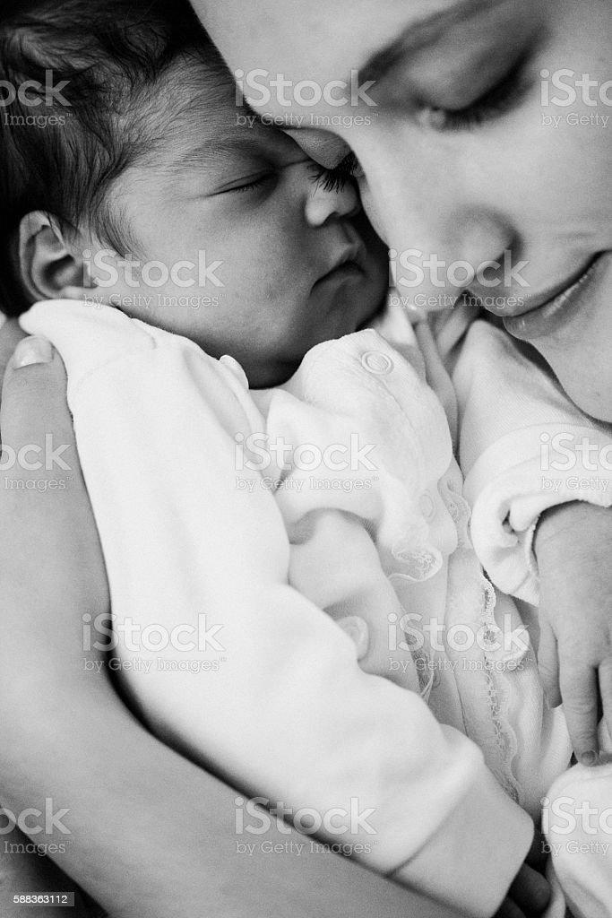 Newborn baby and parents stock photo