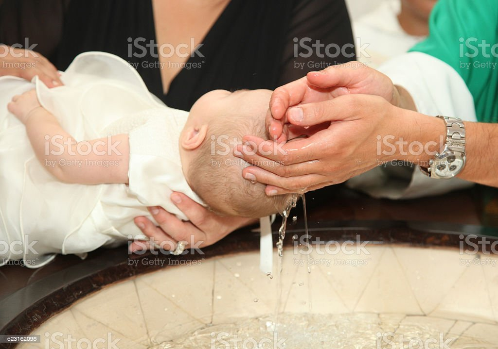 Newborn baby baptism stock photo