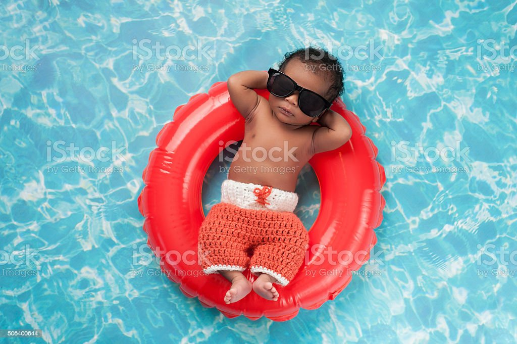 Newborn Baby Boy Floating on a Swim Ring royalty-free stock photo