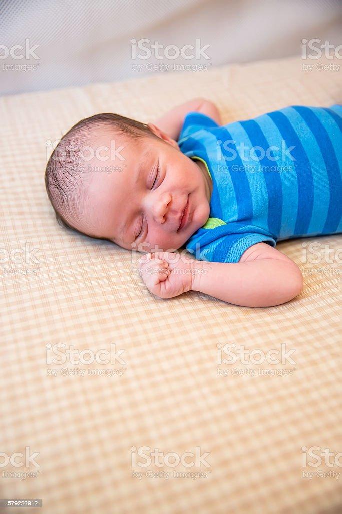Newborn Baby Boy Sleeping in Crib stock photo