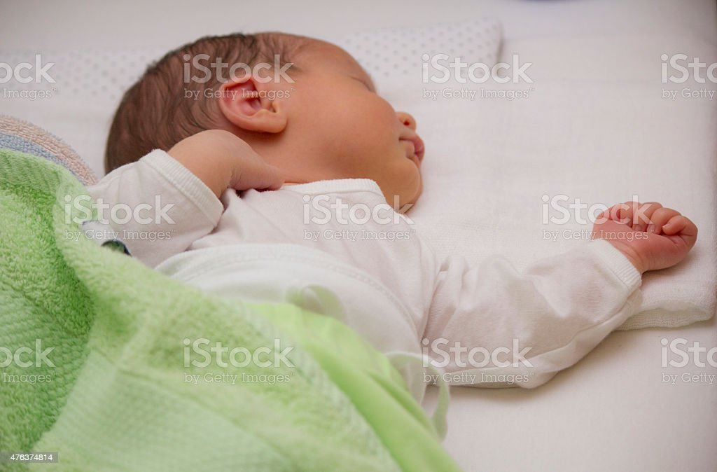 Newborn baby boy sleeping stock photo