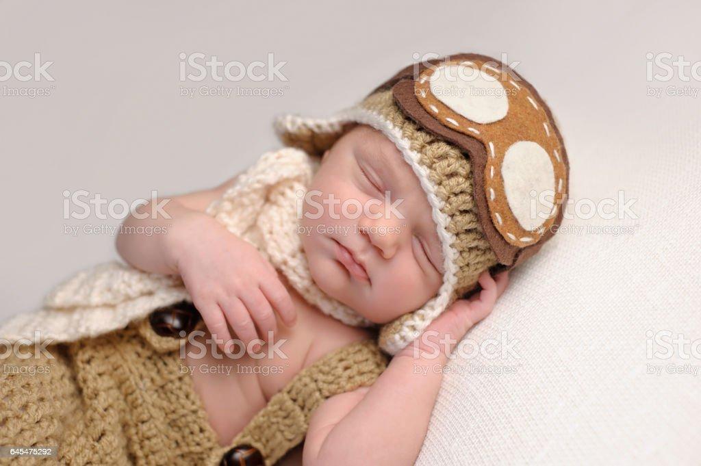 Newborn Baby Boy Wearing an Aviator Hat stock photo
