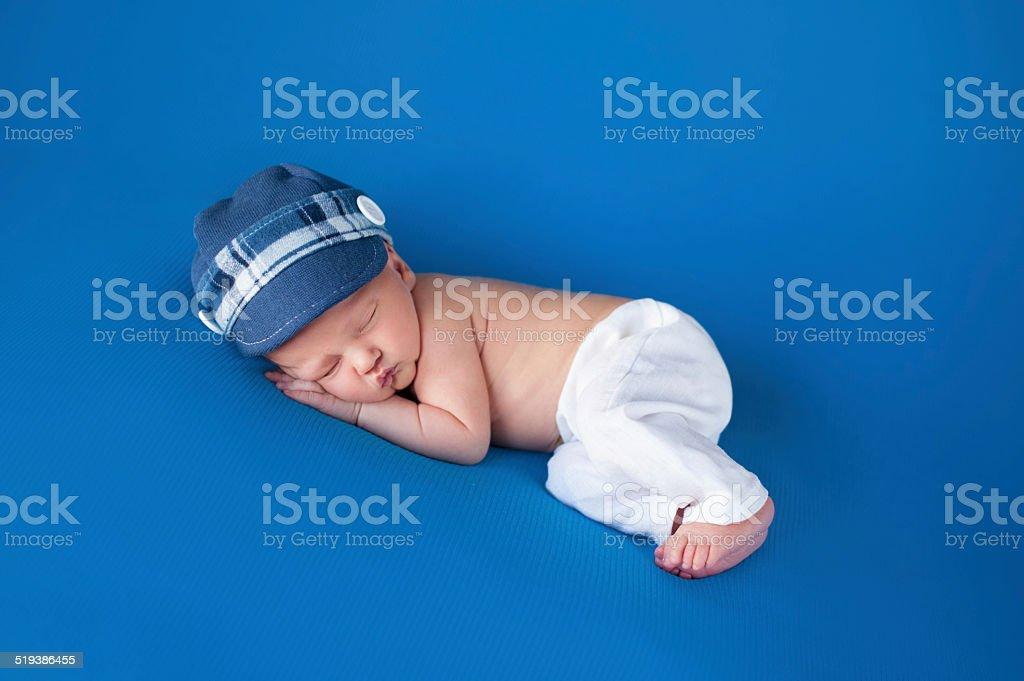 Newborn Baby Boy with Blue Cap stock photo