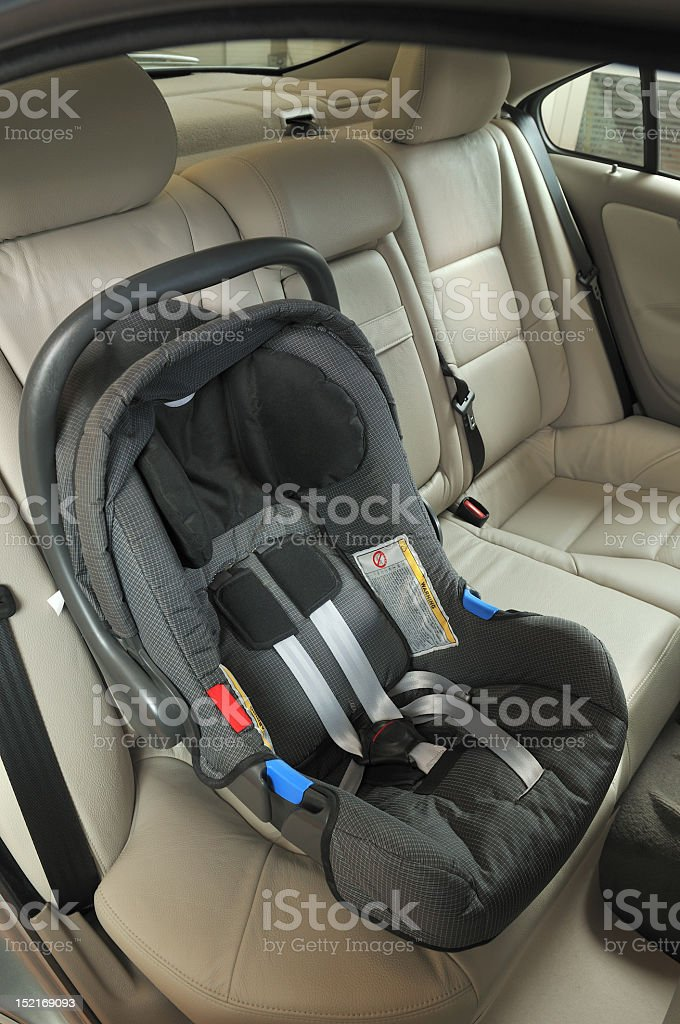 Newborn baby car seat in the car stock photo