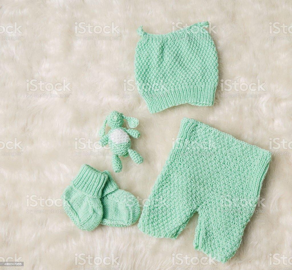 Newborn Baby Clothing, New Born Kids Hat Socks Booties Trousers stock photo