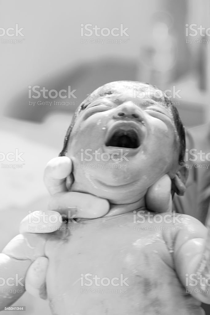 Newborn baby cry stock photo